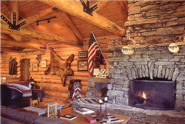 The Interior Of Lodge Features A Beautiful Rock Fireplace